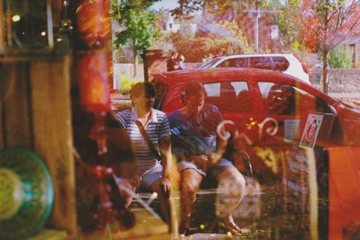 Adelaide-Street-Photography---Adelaide-Hills-German-Hahndorf-Tourists-Reflected-in-Shop-Window